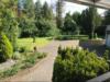Großzügiges Zweifamilienhaus mit Garagen in ruhiger Lage Beckums! - Gartenansicht 1